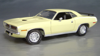 Click image to see more information about our 1970 Plymouth Cuda Yellow chase/white hockey!