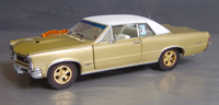 Click image to see more information about our 1965 Hurst Edition GTO with White Vinyl Top!